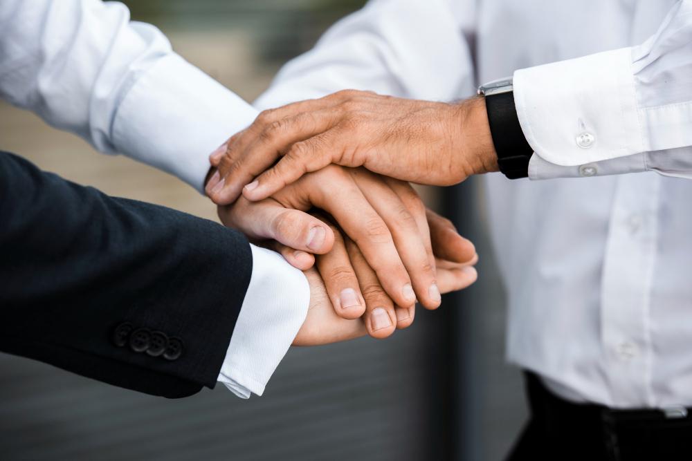 businessmen-with-hands-together