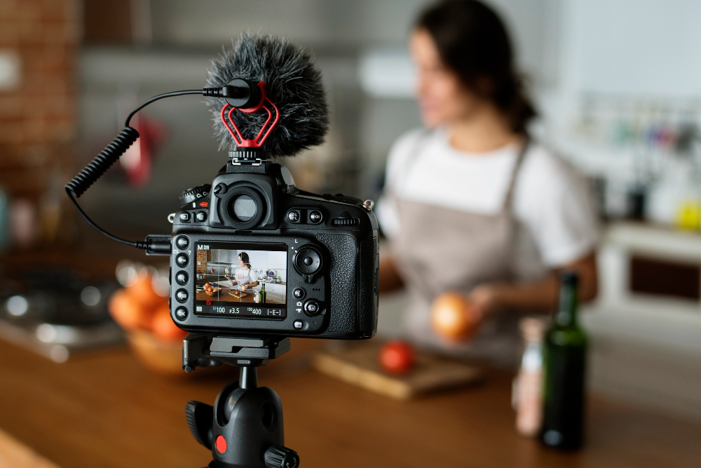 female-vlogger-recording-cooking-related-broadcast-at-home